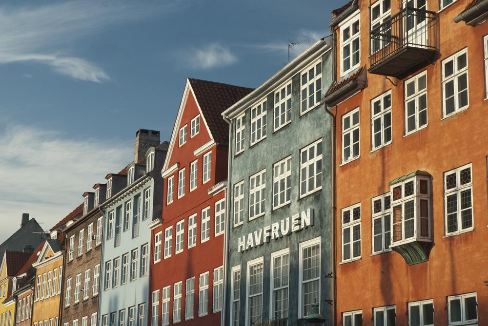 A row of colourful buildings in Nyhavn, Copenhagen, Denmark.